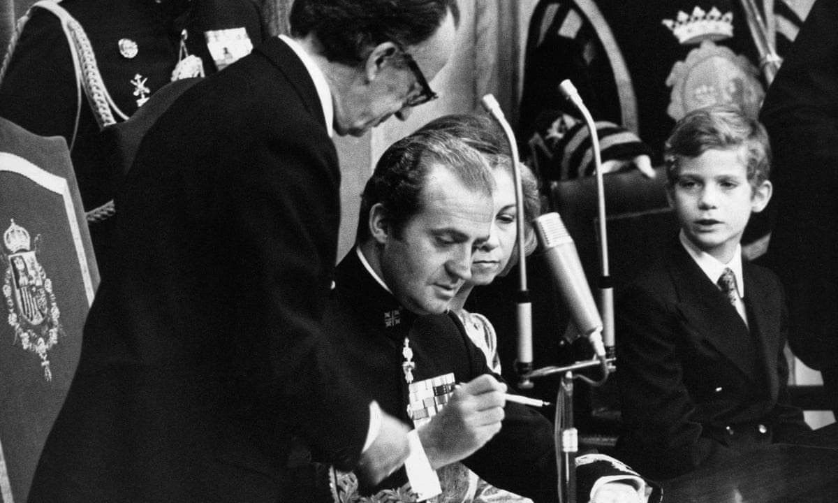 King Juan Carlos I of Spain signs the Spanish Constitution of 1978 at a special joint meeting of parliament in Madrid, establishing Spain as a democracy, 27 December 1978.